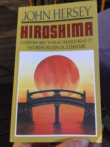 Book cover, large sun rising behind a Japanese style bridge. John Hersey, Hiroshima.